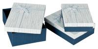 3 dunkelblaue Geschenkboxen mit hellblauem Deckel und...